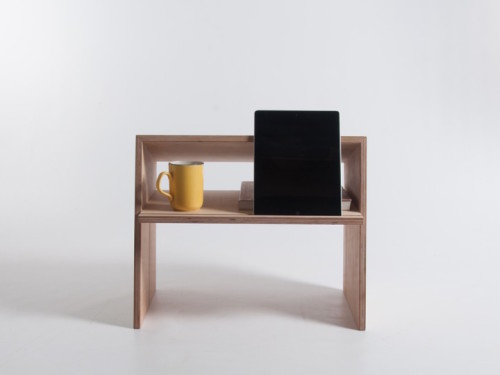 this little desk is a great idea for people who want to break the sedentary routine and try different positions while working on a laptop or tablet